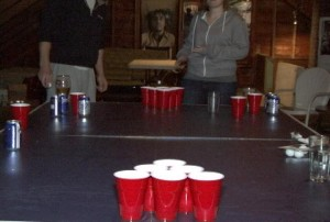 Students play beer pong on Syracuse University campus. The traditional college drinking games has been linked to the spread of the H1N1 virus.